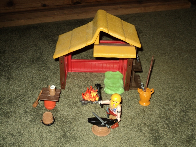 Here is a custom Viking Blacksmith's Workshop that I made. Figure is custom too.
