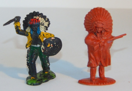 The figure on the right is a Timpo Solid plastic figure.