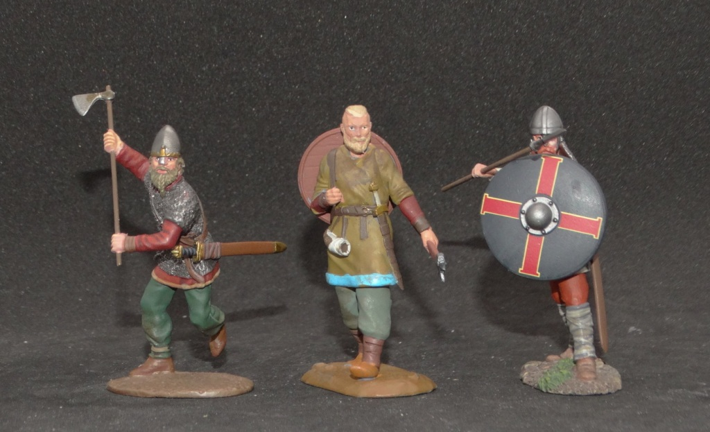 Warhorse Miniatures Viking in the middle of two W. Britain figures.